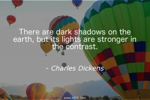 There are dark shadows on the earth, but its lights are stronger in the contrast.